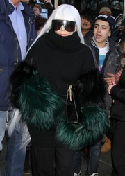 Lady Gaga accessorized with the Acne Studios 'Avatar' gloves, which worked perfectly with her fur-sleeve turtleneck, while headed to the doctor.