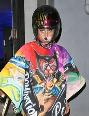 Lady Gaga showed off her quirky style with this motorcycle helmet and graphic-print dress ensemble while leaving the Sunshine Dance Studios.