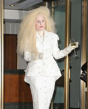 Lady Gaga took matchy-matchy to the extreme with this pearl-studded gloves and skirt suit combo by Thom Browne while out in New York City.