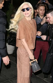 Lady Gaga was spotted outside her NYC hotel carrying a cute framed purse.