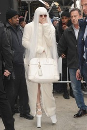 Lady Gaga topped off her ghostly look with a tasseled white tote by Versace.