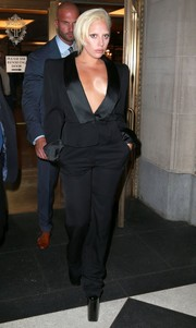Lady Gaga paraded her cleavage in New York City in a plunging black pantsuit by Yves Saint Laurent.