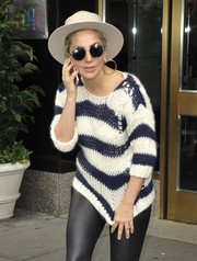 Lady Gaga topped off her daytime ensemble with a white fedora.