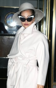 Lady Gaga teamed her shades with an elegant wide-brimmed cloche.