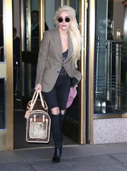 Lady Gaga headed out in New York City wearing a Saint Laurent houndstooth blazer and a pair of torn jeans.