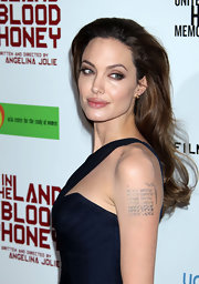 Angelina wore her hair long and flowing a the LA premiere of 'In the Land of Blood and Honey.'