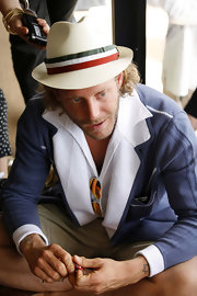 Lapo Elkann finished off his look with a straw hat featuring a colorful band at the Pitti Uomo trade show.