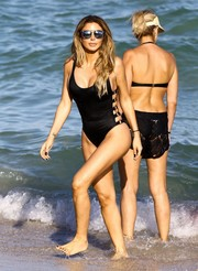 Larsa Pippen looked oh-so-hot in a black one-piece with strappy sides while enjoying a day at the beach.