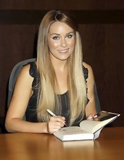 "Former ""Hills"" star Lauren Conrad showed off her writing skills in her new book ""Sweet Little Lies"". While at the book signing she sported a longer than usual hair style."