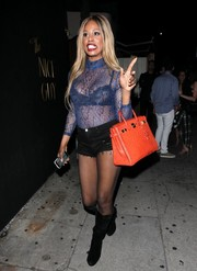 Laverne Cox chose a pair of black knee-high boots to complete her outfit.