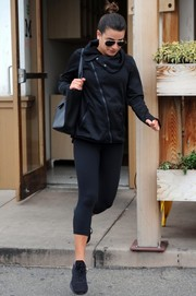 Lea Michele kept it low-key in a black C9 Champion zip-up jacket and capri leggings while grabbing lunch in LA.