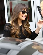 Lea Michele his behind a pair of black Ray-Ban sunglasses before making an appearance at a Kohls department store in Los Angeles.