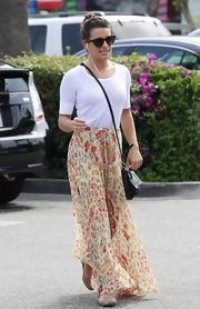 Lea Michele paired a white tee with a long flowing skirt for a casual and relaxed look while out shopping.