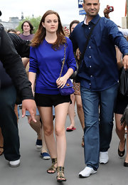 Leighton rocked black shorts with cool, military green, multi-buckled sandals.