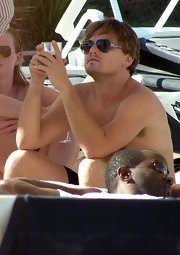 Leonardo DiCaprio was spotted in Ibiza wearing aviators, shorts, and not much else.