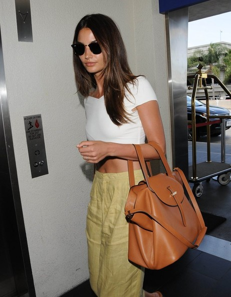 Lily Aldridge caught a flight at LAX carrying a spiffy camel-colored cross-body tote.