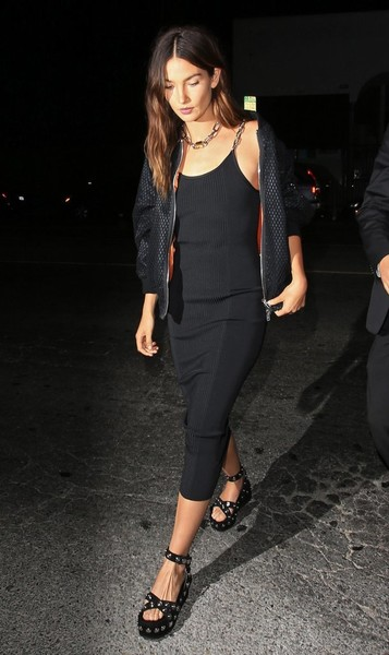 Lily Aldridge went for ultra-edgy styling with a pair of studded wedge sandals, also by Alexander Wang.