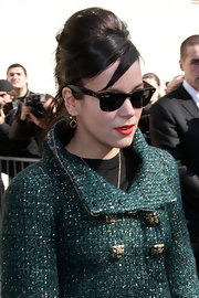 Lily Allen accented her ladylike look with classic black Ray-Ban wayfarers.