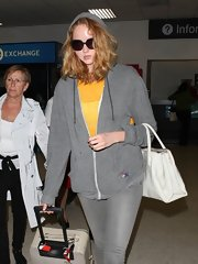 Lily Cole was low-key in a gray hoodie and dark glasses as she arrived in LA.