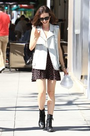 Lily Collins took a stroll in Los Angeles wearing a denim and faux-leather vest by MINKPINK.