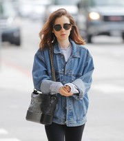 Lily Collins took a stroll in Beverly Hills wearing a pair of square sunglasses.