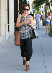 Lily Collins was easy-breezy in a Paige gingham blouse and a pair of harem pants while out shopping in Beverly Hills.