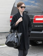 Lily Collins bundled up in a stylish black wool coat for a stroll in West Hollywood.