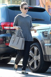 Lily Collins was spotted at a dry cleaners wearing a comfy gray knit top.