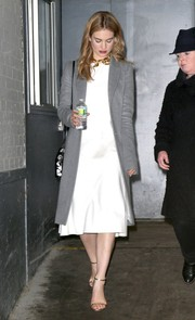 Lily donned a classic gray wool coat over her white dress while out in NYC.