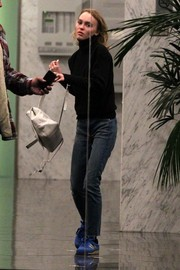 Lily-Rose Depp's white leather backpack looked stylish and practical at once.