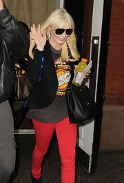 Lindsay Lohan kept things casual at the 'SNL' studios in a gray Harley Davidson T-shirt and red skinny jeans.
