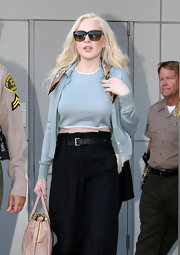 Lindsay Lohan channeled the '50s in a pale blue twin set and tortoiseshell cateyes.