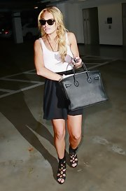 Lindsay Lohan paired her black lace up heels with a coveted Birkin bag.