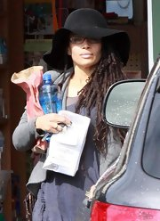 Lisa Bonet ran errands wearing a black large-brimmed hat.