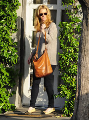 Lisa Kudrow was dressed for comfort in cap-toe ballet flats, jeans, and a light blouse as she visited a salon.