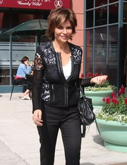 Lisa Rinna looked sexy and girly in this black lace cardigan.