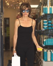Lisa Rinna stepped out of a beauty salon rocking oversized square sunglasses.