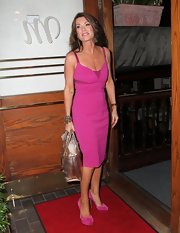 Lisa Vanderpump brought out the bold colors at dinner when she wore this fuchsia frock.