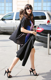 Liv Tyler headed out to a Givenchy commercial shoot wearing a pair of black strappy heeled sandals.