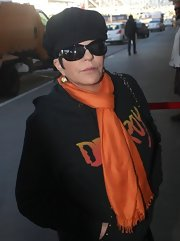 Liza Minnelli was seen departing on a flight wearing a black newsboy cap.
