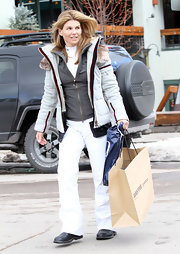 Lori gets her warmth on in a thick snow boarding jacket with fur trim.