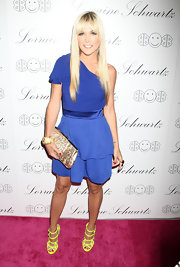 Tinsley Mortimer added an exotic touch to her attire with a snakeskin frame clutch.