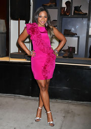 Ashanti dazzled in glimmering silver sandals. She paired the crystal-embellished ankle strap heels with a magenta ruffled dress.