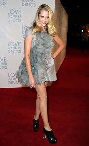 Teresa Palmer paired a ruffled mini dress with unexpected black ankle boots featuring clear chunky heels.