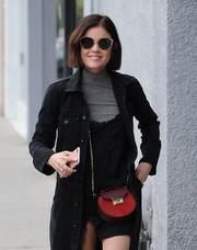 Lucy Hale accessorized with a red chain-strap bag by Salar for a pop of color to her dark outfit while out in West Hollywood.