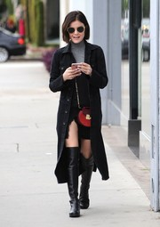 Lucy Hale went edgy on the streets of West Hollywood in a black denim coat teamed with an LBD and a gray turtleneck.