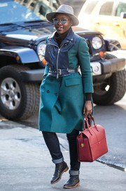 Lupita Nyong'o headed to the Public Theater wearing an aqua-blue wool and leather coat.