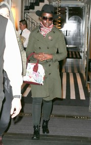 Lupita Nyong'o paired her coat with flat patent boots.