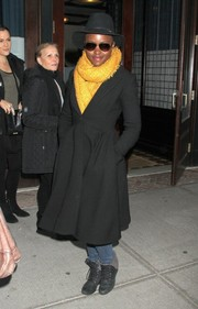 Lupita Nyong'o traded in her elegant heels for a comfy pair of lace-up cuff boots while out in New York City.