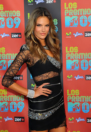 Alessandra Ambrosio paired her lace clad dress with a sparkling bangle bracelet.